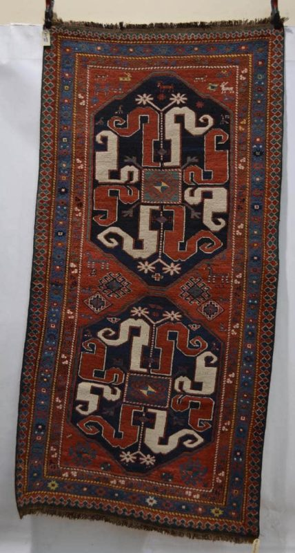 Chondzoresk double medallion rug, Karabakh, south west Caucasus, late 19th/early 20th century, 7ft. 8in. x 3ft. 10in. 2.34m. x 1.17m. (Netherhampton Salerooms 9 December 2015)