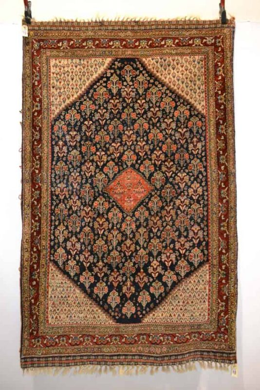 Lot 457. Silk wefted floral rug by the Kashkuli taifeh of the Qashqa'i Confederation, Fars, south west Persia, late 19th century, 6ft. 6in. x 4ft. 1in. 1.98m. x 1.25m. Estimate £2,500-3,500