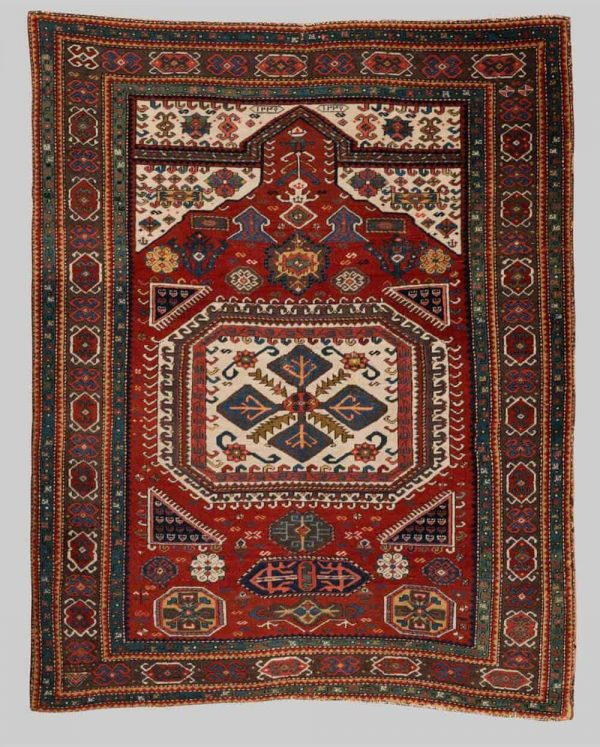 Lot 54, a Caucasian prayer rug dated 1821, 4 ft. 1 in. x 3 ft. 2 with an estimate of $20,000-40,000