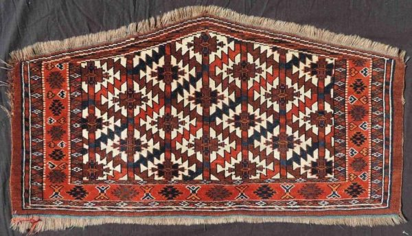 Lot 340, an antique Yomud Asmalyk, mid 19th century, 59 cm x 114 cm.
