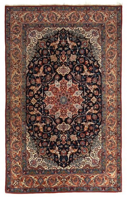 A Isfahan rug, Persia. Classical medallion design. Knotted with kork wool on silk warps. C. 1 mio. kn. pr. sqm. 1950-1960. 246 x 145 cm. Est. 2000 Euro.
