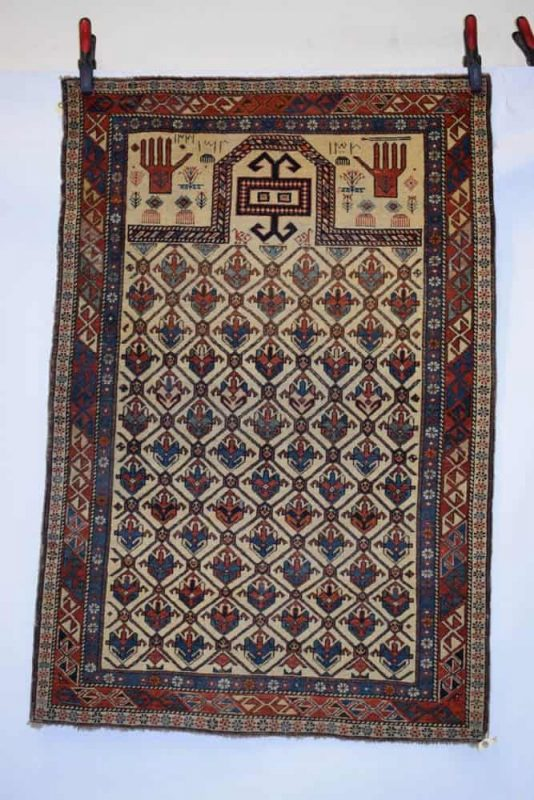 Lot 371. Daghestan white field dated prayer rug, north east Caucasus, late 19th century, 4ft. 8in. x 3ft. 1in. 1.42m. x 0.94m. Estimate: £1500-2000