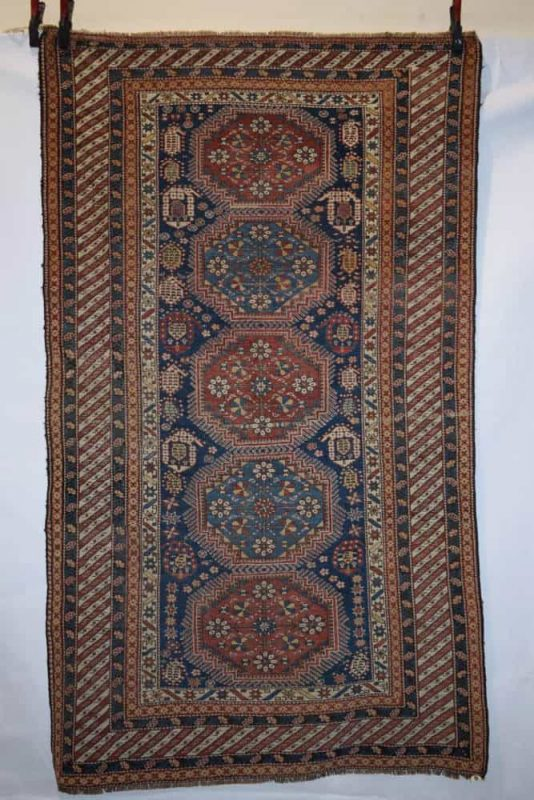 Lot 391. Shirvan-Baku rug, Khila district, south east Caucasus, second half 19th century, 7ft. 6in. x 4ft. 4in. 2.29m. x 1.32m. Estimate: £2000-2500