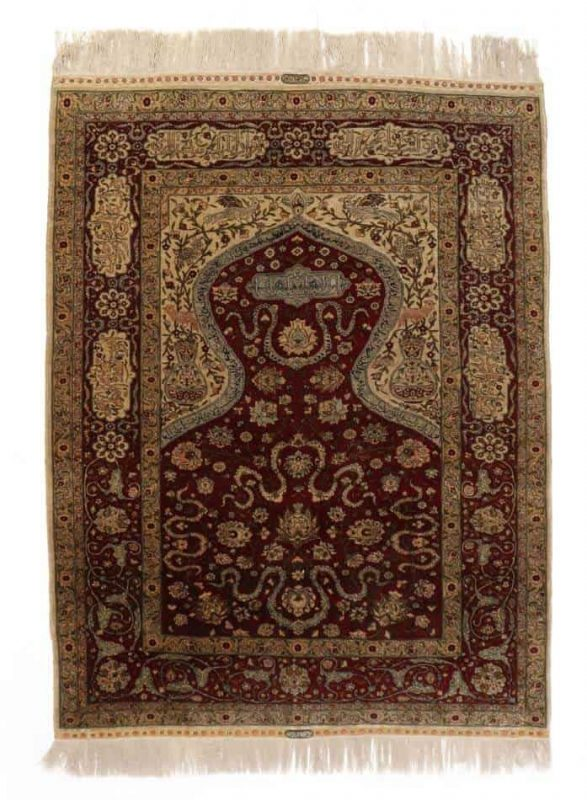 A signed silk and metal thread Hereke rug, Turkey. C. 800.000 kn. pr. m2. Second half 20th century. 175 x 127 cm. (Bruun Rasmussen September 2017)