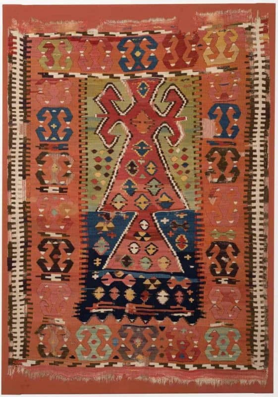 Woven wool prayer kilim from Cappadocia, Central Anatolia c.1830. Mounted on a fabric covered stretcher 156 x 109 cm. Joss Graham at Hali Fair