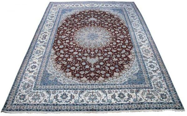 A signed oversize Nain palace carpet 600x373 - Oriental rugs and carpets at Bruun Rasmussen