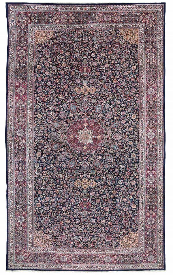 A large Meshed carpet signed Amoghli North East Persia circa 1930