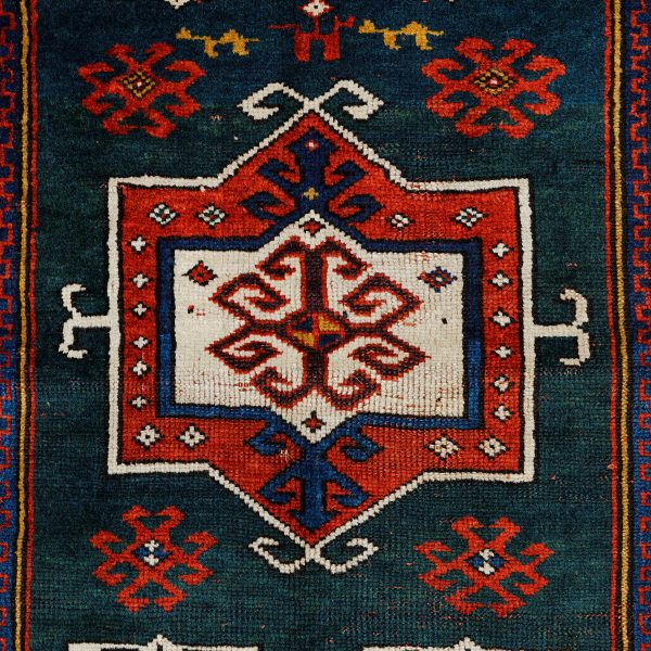 Detail of lot 52, a Fachralo Kazak prayer rug.